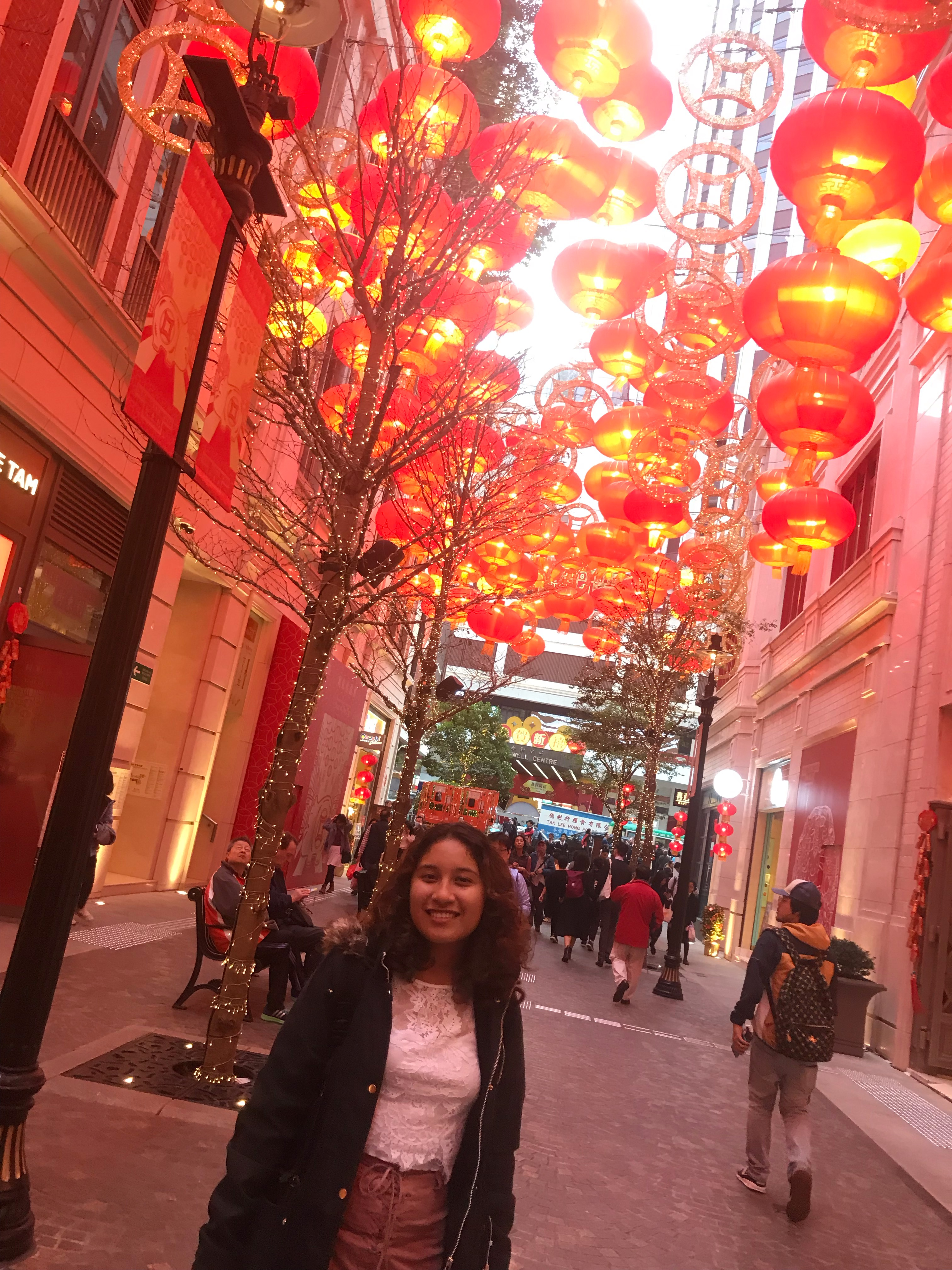 Chinese New Year  My roommate and I were exploring Hong Kong when we came out from the station in a neighborhood called Wan Chai. The street was filled with red decorations to welcome Chinese New Year