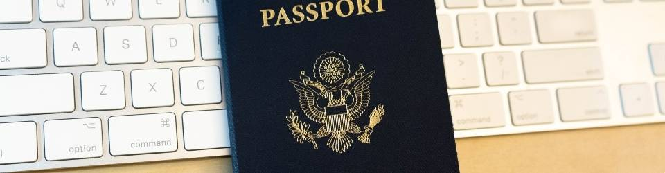 USA Passport over a computer keyboard